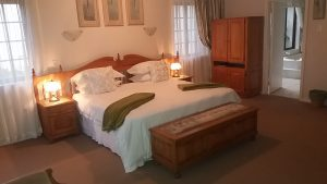 Luxurious king-size bed in the honeymoon room